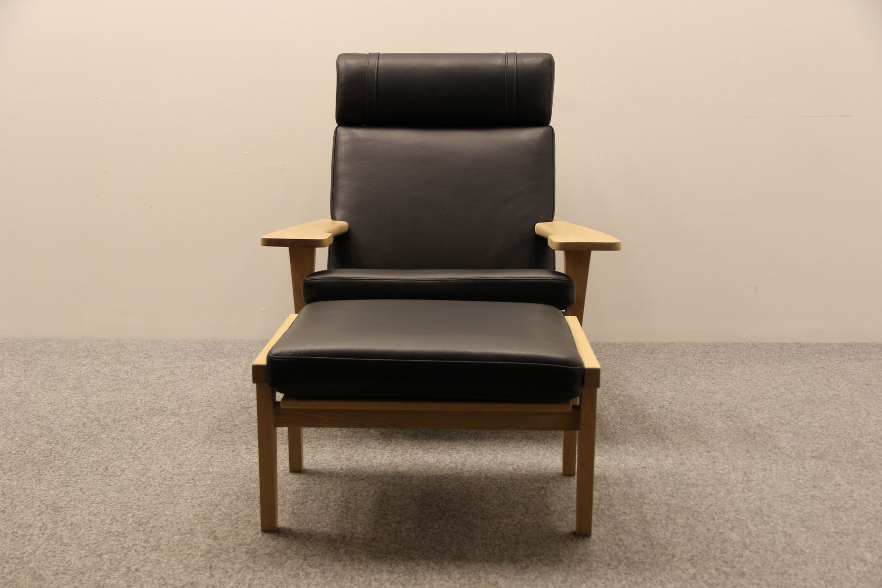 Danish Oak and Black Leather Easy Chair and Ottoman from Getama